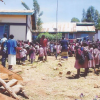 Pupils listen carefully during school parade meeting